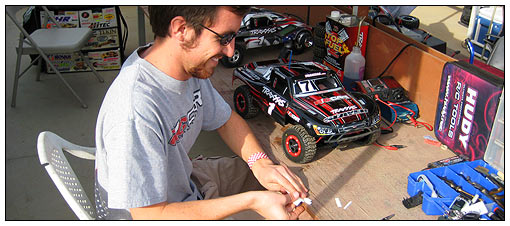 "RC Car magazine's Aaron Waldron readies his ride. You can bet he used all the tips from ""How-To: Get Your Slash Race-Ready"" in RC Car's December issue!"