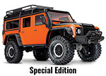 Orange TRX-4® Scale and Trail™ Crawler with Land Rover® Defender® Body:  1/10 Scale 4WD Electric Trail Truck. Ready-to-Drive® with TQi Traxxas Link™ Enabled 2.4GHz Radio System, XL-5 HV ESC (fwd/rev), and Titan® 550 motor.